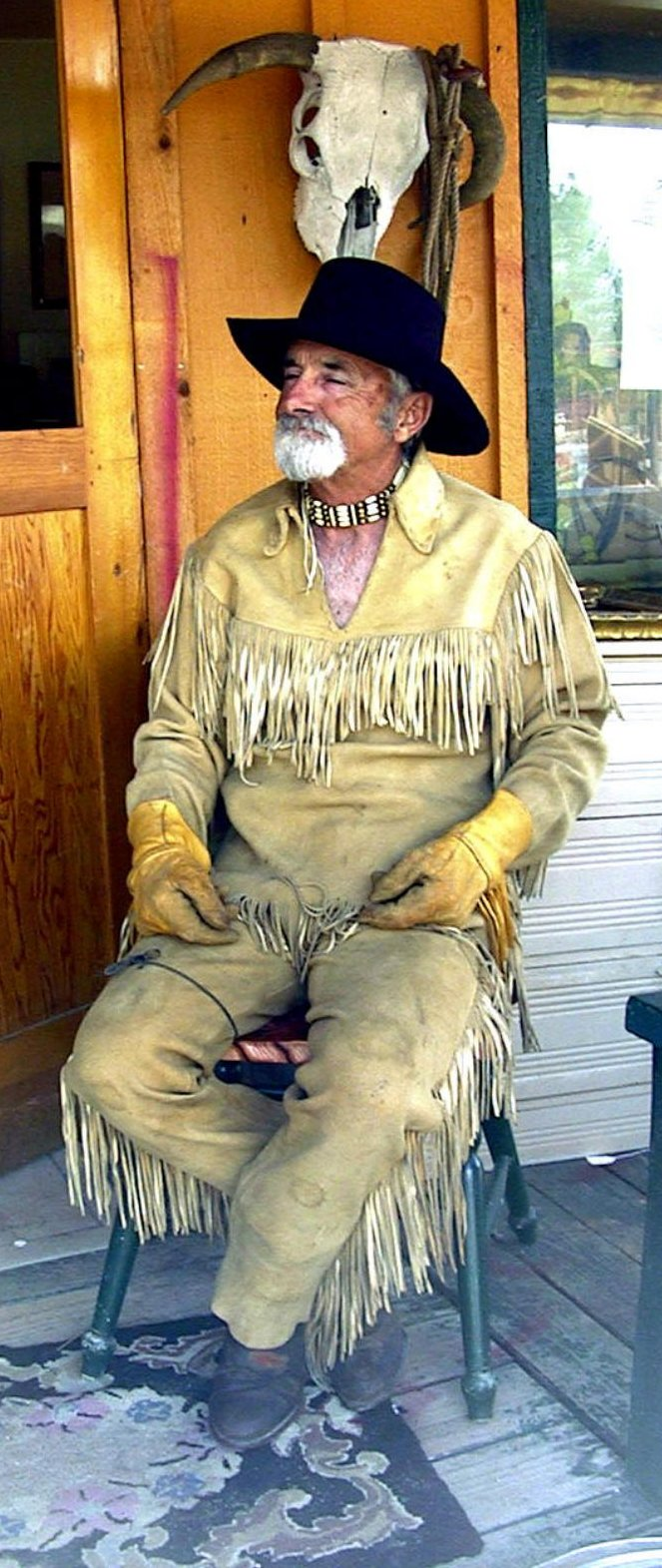 Ron Dakotah in his fringe on the front porch of the Rusty Cowboy